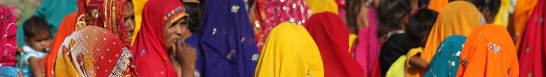 Women in brightly coloured saris, India.